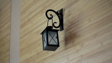 beautiful candle holder hanging on wooden wall