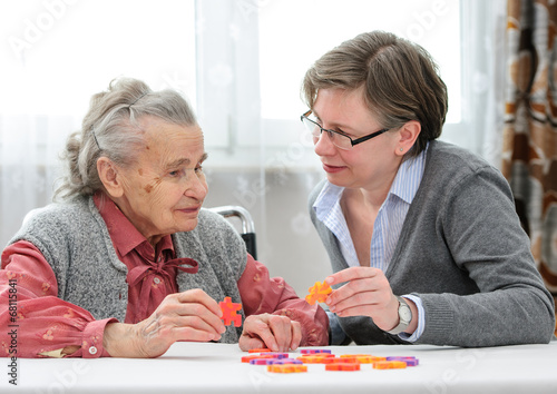 Senior woman with her elder care nurse - 68115841