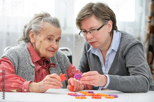 Senior woman with her elder care nurse - 68115852