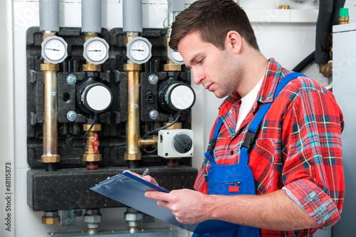 Leinwanddruck Bild Technician servicing heating boiler