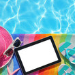 Tablet with blank screen by poolside with beach accessories - 68116067