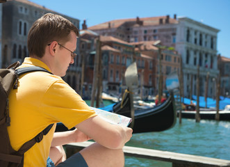 Young man with map in Venice