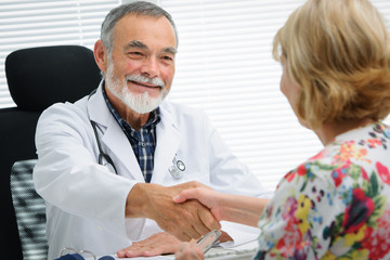Doctor shaking hands to patient