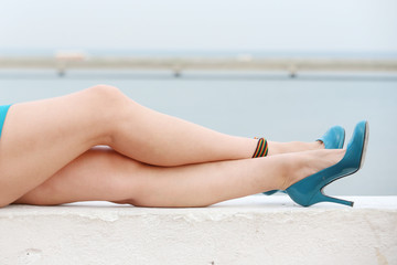 Beautiful female legs outdoors