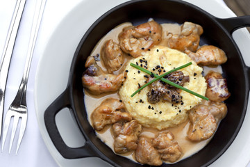 Sweetbreads with sauce in a dish, pollenta and morels