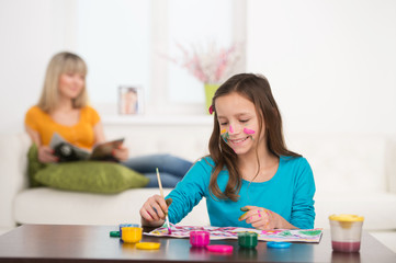 little girl drawing colorful picture.