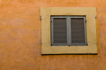 old facade with closed window, Italy