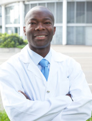 African chemist in front of his lab