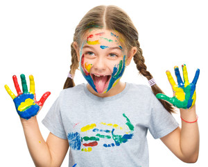 Portrait of a cute girl playing with paints