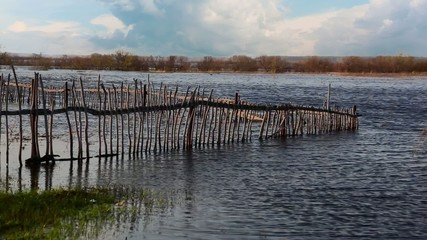 Flooded Old Wooden Fence in the Field.