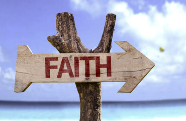Faith wooden sign with a beach on background