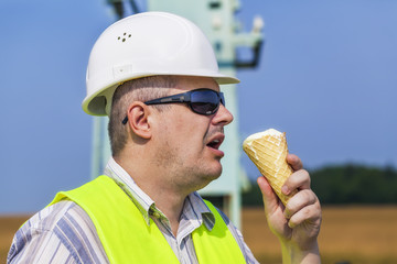 Worker with ice cream on a blue sky background