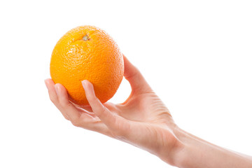 orange in a female hand