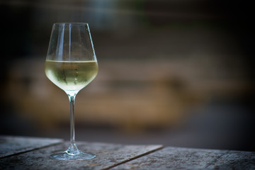Chilled white wine in a glass , with copy space