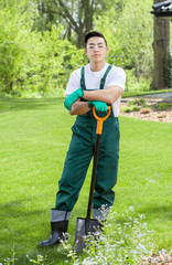 Young gardener with shovel
