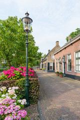 Old street with historic houses in a Dutch village