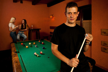 Man playing billiard in a bar