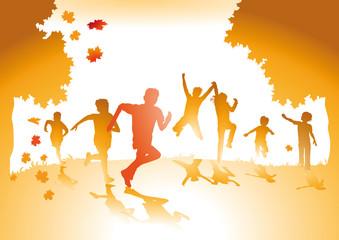 Kinder mit Herbstlaub