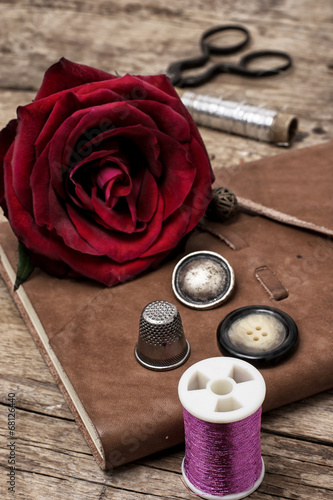 canvas print picture red rose and sewing accessories and tools