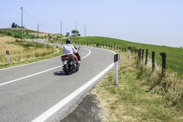 Scooter travels on a road