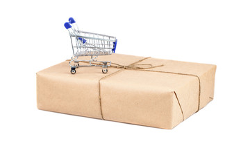 Shopping cart on box on white isolated background