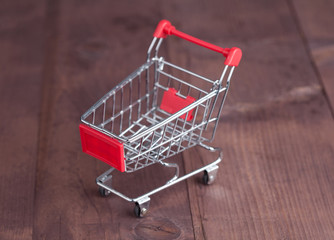Shopping cart on wooden surface