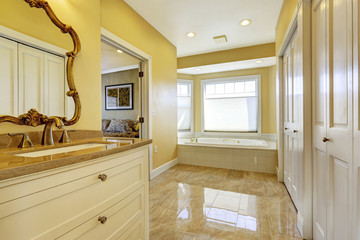 Bathroom with shiny tile floor in master bedroom