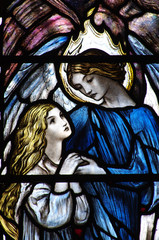 An angel helping a girl (a stained glass window)