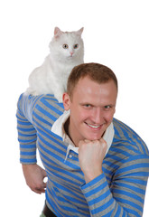 white cat sits on a shoulder at the young man