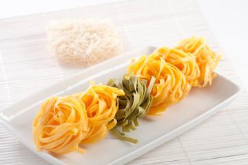 Dry pasta on white plate horizontal