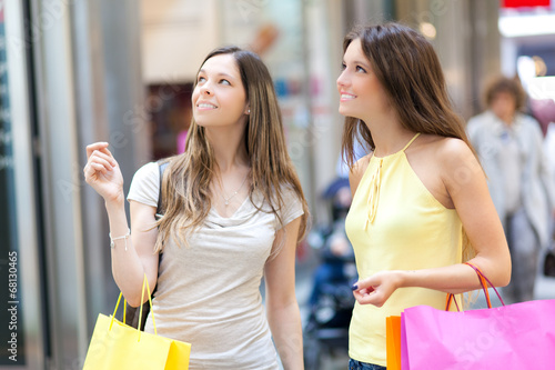 Two girls shopping in the city