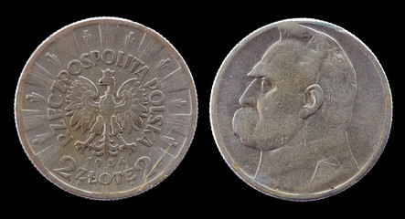 Two Polish Zloty coin of 1934 year isolated on black background.
