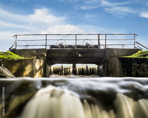 Water gate in the system of lakes in Peterhof on a sunny day - 68131466