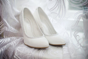 White shoes on a window sill.