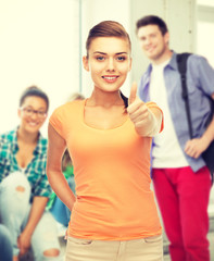 woman showing thumbs up at school