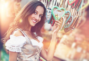 Woman in Dirndl costume with Gingerbread heart