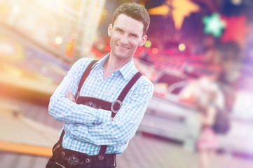 guy in Bavarian Lederhosen with his arms folded