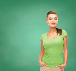smiling young woman in blank green t-shirt