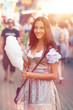 German Girl wearing a Dirndl and eating candyfloss