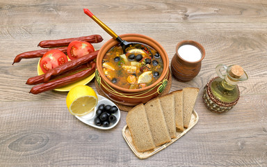 thistle soup and other food on a wooden background