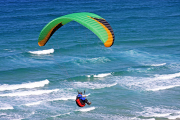 paraglider over the sea