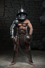 Gladiator in helmet and armour holding sword