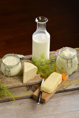 Basket with tasty organic dairy products on wooden table