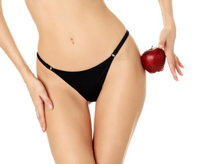 Slim woman with apple