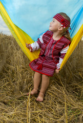 little girl in a wheat field