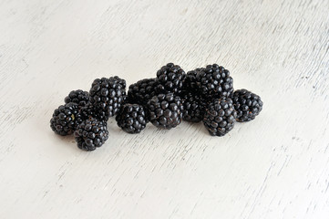 Blackberry on White Wooden Background