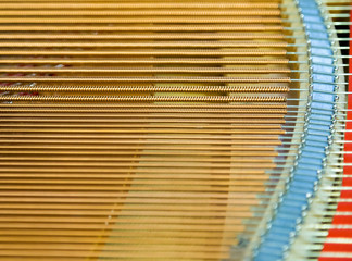 igold strings inside of a piano