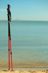 nordic walking. sticks on a sandy beach. ocean view