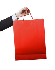 Man hand carrying and showing a Red  Shopping Bag