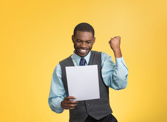 Happy man holding document receiving good news yellow background